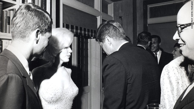 Robert F. Kennedy, left, Marilyn Monroe and President John F. Kennedy in 1962 photo taken by Cecil Stoughton. Historian Arthur Schlesinger is on the far right. Singer Harry Belafonte can be seen facing the camera in the rear. Source: CNN